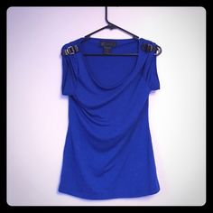 Kardashian Kollection Top Royal blue Kardashian Kollection top. Has buckles on the shoulders. A great top to pair up with black leather pants or leggings. It is a size small. Kardashian Kollection Tops Tees - Short Sleeve