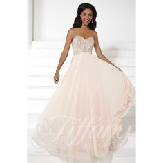 Tiffany Design Style 16078 The strapless sweetheart bodice of this romantic gown features metallic embroidery and heat-set AB stones. A slimming empire waistline flows into a silky chiffon skirt.