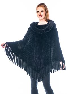 A mink poncho is both practical and pretty! Keep warm in style with this easy to wear knitted mink poncho.Wherever you go, your winter days will be welcomed Winter Poncho, Poncho Coat, Fur Cape, Madison Avenue, Black Knit, Keep Warm, Personal Style, Mink Fur, Fringes
