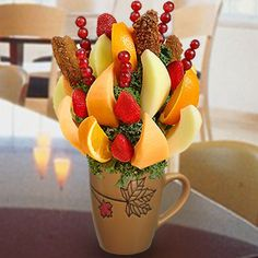 Chocolate Dipped Orange Wedges - Take a break even sweeter with this delicious fruit arrangement that comes in a Mapple Leaf, reusable mug. You can create your own edible fruit arrangements. Price starts from $25   http://www.VaaV.ca