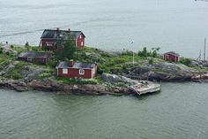 Typical Finnish island with colorful houses built on it.