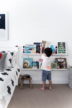 Kid's books are on display and off the floor with these nifty wall-mounted shelves from IKEA Ikea Wall Shelves, Nursery Shelves, Wall Mounted Shelves, Wall Bookshelves Kids, Kids Room Shelves, Shelf, Ikea Kids, Kids Toy Store, Creative Kids Rooms