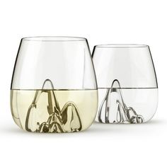 "Modeled after the popular Glasscape Bowl, the Escape glass is a typical glass vessel with the bottom inverted upward, into a mountainous terrain of glass. Each piece is uniquely hand-blown so that no two are exactly alike. This interior form allows the contents to stay cooler for a longer period of time, Set of 4 glass tumblers. Each glass measures 3.6"" x 3.75"" Please allow 2 weeks for delivery"