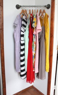 """Corner clothes bar ~ quote the blogger: """"It's the perfect amount of """"closet space"""" for a guest staying for the weekend..."""" (personal note: It would be easy to dress it up with paint, decoupage or even a well-fitted fabric sleeve - and I would like a triangular shelf installed above it). - from radicalpossibility blog"""