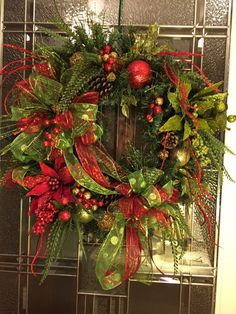 Christmas Red and Bright Green Poinsettia Glitter Wreath  If you're going to go all out, go all out.  Embrace the artificial?