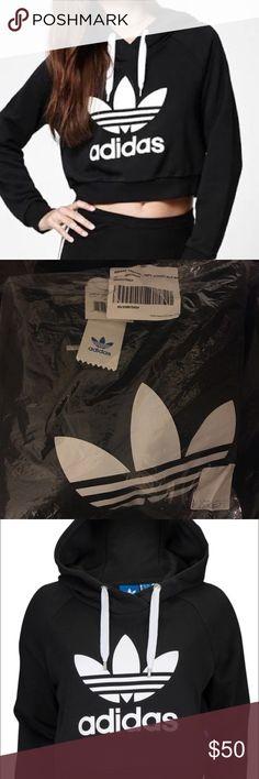 Trefoil Adidas hoodie Medium crop top trefoil Adidas hoodie. Brand new. Never worn. With tags. Adidas Tops Sweatshirts & Hoodies