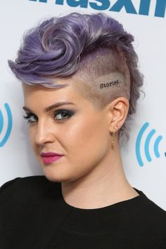 Pin for Later: Ariana Grande Beats the Heat With a Perfect Pony Kelly Osbourne Kelly highlighted her new tattoo with a swirly mohawk hairstyle when she visited the Sirius XM Studios.