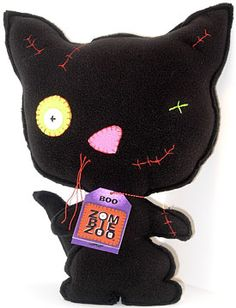 """Boo2Yoo MB78365 45""""H Mini Boo Clip on - Black     is 4-5 high constructed of soft black fleece sporting an original turned-inside-out look Frankenstein quality embroidery stitching red whiskers and green eyes. Adorning his neck is his personality tag and the DVD ZombieZoo Story on a chain. It s the perfect gift for that natural born leader or explorer looking for a collectable story and plush zombie cat to bond with and hug."""