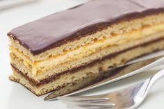 This opera cake recipe features layers of almond sponge cake soaked in espresso syrup, coffee buttercream, and chocolate ganache. Original opera cake recipe.