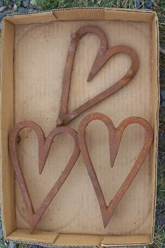 I love these old heart-shaped, vintage trivets that I photographed at a local auction! Photo by Carol Jacobs Norwood.