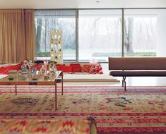 Now, a tip for next-level lounging: a conversation pit. The mother of conversation pits resides at midcentury gem the Miller House in Columbus, Indiana. Designed by Eero Saarinen, decorated by Alexander Girard, with textiles by Jack Lenor Larsen, this living room setup is a classic for a reason. Photo by Leslie Williamson.