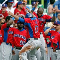Dominican baseball players celebrating victory in the World Baseball Classic