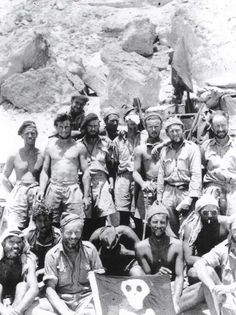 Members of the Long Range Desert Group in the North-African desert with a Jolly Roger (circa 1942)