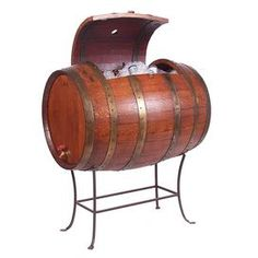 """Eco-friendly barrel-inspired cooler with a water-tight design and iron stand. Made in the USA.   Product: CoolerConstruction Material: Wine barrel oak, steel and PVC linerColor: BrownFeatures: Drain faucetDimensions: 42"""" H x 37"""" W x 26"""" D"""