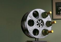 Roll camera! Classic Hollywood comes to life in a scene stealing wine rack—repurposed midcentury film reels make the perfect modern wine rack; classic film nostalgia for celluloid and sauvignon blanc lovers alike. For added delight —each reel is wound with a vintage MGM movie... The name of the actual film included on an enclosure card nested in the box. Authentic, unique, absolutely a star.  $375.00