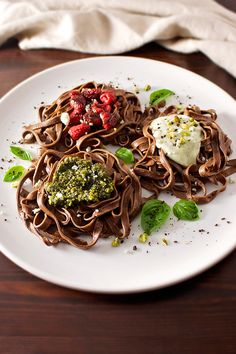 This chocolate cocoa-infused pasta is topped with roasted balsamic vinegar berries, pistachio pesto, and creamy Gorgonzola sauces, full of decadent flavor.