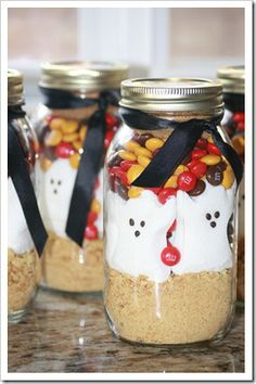 """Smores in a jar: Ingredients:  1 quart mason jar  1 sleeve graham crackers  1 package holiday marshmallow peeps  one bag of holiday M candies  1/3 cup of brown sugar Cooking directions:  1. Empty the jar contents into a bowl.  Snip the peeps into bits with kitchen shears or cut up with a knife.  Return the peep bits to the mixture. Mix well.  2. Melt 1/2 cup butter; add 1 teaspoon vanilla. Pour this over the dry ingredients, mixing well. Pat into a greased 8"""" or 9"""" square pan. Bake at 350…"""