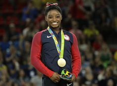 United States' Simone Biles smiles on the podium after winning vault gold during the artistic gymnastics women's apparatus final at the 2016 Summer Olympics in Rio de Janeiro, Brazil, Sunday, Aug. 14, 2016. (AP Photo/Dmitri Lovetsky