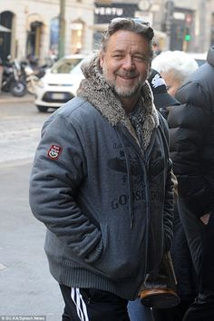 Casual: Russell Crowe ditched his sophisticated Milan Men's Fashion Week look for a tracks...
