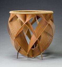 Shono Shounsai was named Living National Treasure in 1967 Kyushu: active in Shiraki, Oita Prefecture Bamboo (madake), rattan, and copper alloy Selected techniques: thousand line construction H. 13 3/4 in x Diam. 14 in. Lloyd Cotsen Japanese Bamboo Basket Collection, 2006.3.836 (B-1095); catalogue no. 50 Photograph by Kaz Tsuruta.
