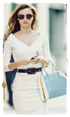 Miranda Kerr Handbags Style - Stunning In Leather Prada Saffiano Tote Bag |  Miranda's favorite baby-blue Prada bag gave her ladylike look a soft (but still powerful!) pop of color, attends a business meeting in New York City in a Victoria Beckham dress.