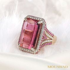 A 17.58-carat pink-red tourmaline surrounded by sapphires and diamonds ― a refined work of art. #Mouawad #MouawadDiamondHouse #RareJewels