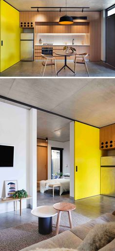 A bright yellow door adds a pop of color to this apartment and slides open to reveal the bedroom.