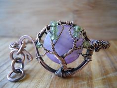 Tree of Life Bracelet Chevron Amethyst and Green Peridot Wrapped on Hammered Oxidized Copper Wire. $37.11, via Etsy.