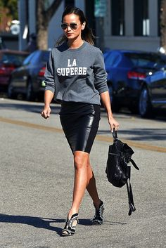 $64 - $1695 Le Fashion Blogger models a pencil leather skirt teamed with graphic sweatshirt, backpack and black and white high heel sandals for a complete out & about look.
