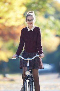 Longer skirt, but this outfit is super cute! Love the sweater and the glasses!