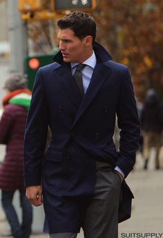 Navy coat, blue shirt, green tie
