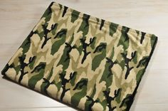 """Camo Minky Baby Boy Blanket  Every baby boy will love this camo theme blanket. This blanket is great for snuggles, bed, car, couch or floor. It has a textured black minky back. It measures approximately 35"""" x 27""""  Click for more photos"""