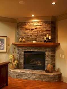 20 Appealing Corner Fireplace in the Living Room Tags: corner fireplace ideas modern, corner fireplace ideas in stone, corner fireplace decor, corner fireplace design ideas, fireplace ideas for corner Corner Stone Fireplace, Fireplace Redo, Fireplace Hearth, Fireplace Remodel, Living Room With Fireplace, Fireplace Surrounds, Fireplace Ideas, Corner Fireplaces, Simple Fireplace