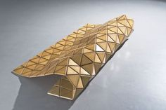 Woodskin® is a composite material, developed and patented by our design firm. This highly flexible surface – a sandwich wood and high performance mesh – was created by a process of excavation with a CNC cutting machine.
