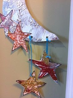 paper mache crescent moon mobile- decorate with gold glue and glitter, think of interesting way to make stars ( perhaps overhead projector sheets