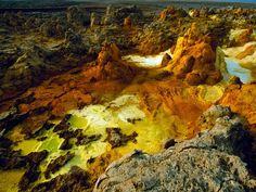 Dallol Volcano - Sulfur, salt, and other minerals color the crater of Dallol, a volcano in the hottest place on Earth, Ethiopia's Danakil Depression. At 157 feet (48 meters) below sea level, Dallol is also the world's lowest land volcano.