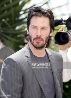 Keanu Reeves during 2006 Cannes Film Festival 'A Scanner Darkly' Photocall at Palais des Festival Terrace in Cannes France