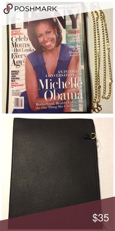 """Michelle Obama Magazine Clutch Purse Magazine style clutch with an added chain to convert as a shoulder strap purse. 12-5/8"""" x 9"""".  Clutch comes with a purse cover as an added bonus. This is a collectors item for sure. Only a few left in stock. PRICE IS FIRM. Bags Clutches & Wristlets"""