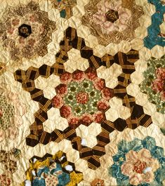 Mosaic Star-detail.  Quiltmaker lived 1776 to 1856; married 1795. Fabrics in quilt are primarily early 19th-century chintz and good examples of 1825 period.