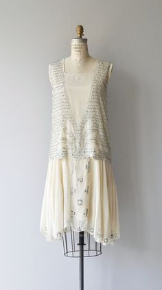 Antique 1920s ivory silk dress with stunning metallic silver beading, classic…