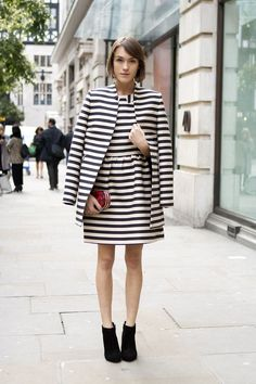Shop this look on Lookastic:  http://lookastic.com/women/looks/white-and-navy-skater-dress-white-and-navy-coat-red-clutch-black-ankle-boots/8775  — White and Navy Horizontal Striped Skater Dress  — White and Navy Horizontal Striped Coat  — Red Leopard Leather Clutch  — Black Suede Ankle Boots