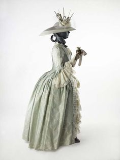 Fashion 18th Century ball gown dress ensemble costume circa from 1752-1775. Made from very fine silk, lace and trim with embroidered small flower floral pattern in off white woven into the pale blue background. Hat decorated with millinery flower.