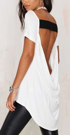Edgy look | Black and white open back loose top with fake leather leggings