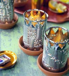 Tin Can Luminarias These easy-to-make tin lanterns are the perfect accent to scatter around a porch or patio for a charming, folk art touch.