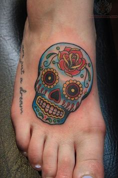 Rose Head Sugar SKull Tattoo On Foot. Don't like the position but love the skull.