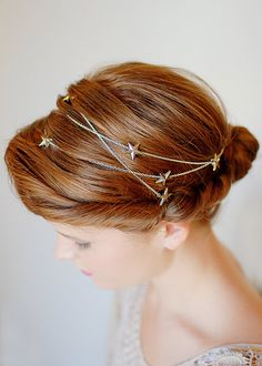 Feel magical for a day with this star-studded piece. A silver strand with matching stars can be worn as a headband or intermingled into a