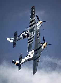"""youlikeairplanestoo: """" Two P-51 Mustangs fly in formation during a demonstration at the 2009 Rhode Island National Guard Open House and Airshow. Great shot by Matt Hintsa. Full version here. """""""