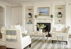 Refreshing living room palette of white and gray, by Louise Brooks. #stylish #fireplaces