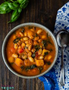 Vegan White Bean Kale Stew with Squash // Just by looking at the beautiful warming and rich color of this soup is enough to get us in a better mood. The taste is even more wondefrul. | The Green Loot #vegan #comfortfood
