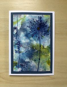The background is made using a gel plate with alcohol hand gel and drops of alcohol ink on it and then dragging Rnager gloss finish paper through it.The stamp is Paperartsy EKC02 and sentiment is Papertrey Ink Swoosh